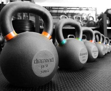 kettlebells lined up in personal trainer daventry gym for hiit classes